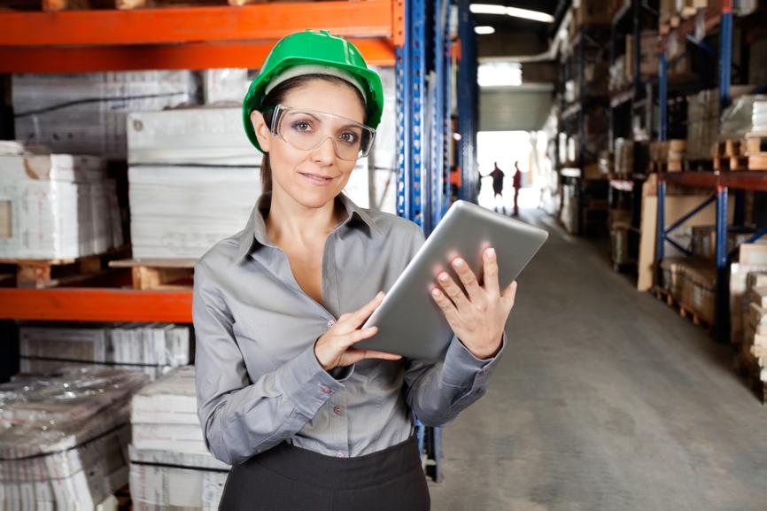 Female Supervisor Using Digital Tablet At Warehouse