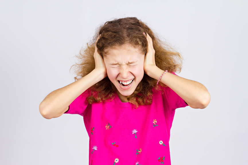 Stressed teen girl screaming, shouting