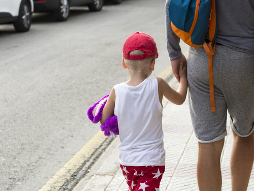 Child with a toy on the street